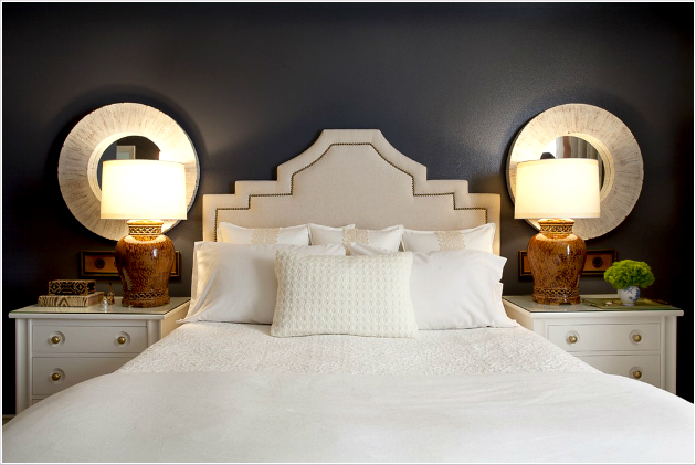 The Most Iconic Bedside Lamps the most iconic bedside lamps The Most Iconic Bedside Lamps Bedroom Contemporary Orange County bedside table blue walls dark walls nailhead trim nightstand round mirrors table lamps upholstered headboard wall decor white bedding id 1443
